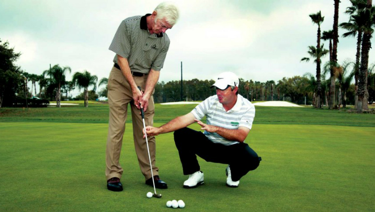 a man getting coached on golf