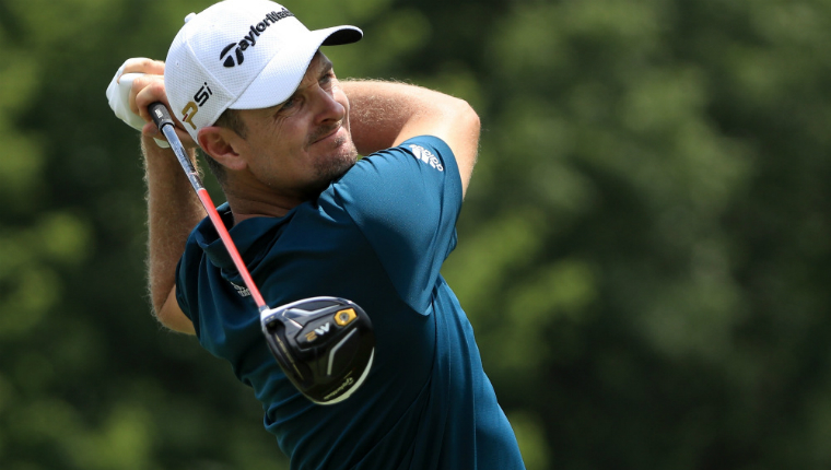 justin rose playing an iron